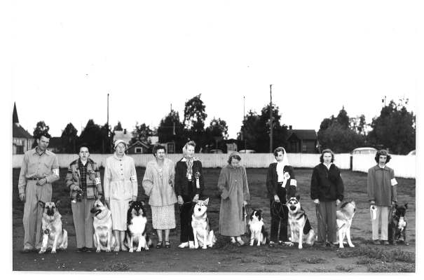 The photo of the qualifiers from the first trial includes the following (from left to right):  Harry Braun & Corsair, Maralee Columbia & Blitzen, Barbara Berg & Sassie, Judge Mrs. Marjorie E. B. Hess, Jean Sellens & Yakatat, Barbara Ann Berg & Gay, Barbara Parker & Rex, Kit McInnes & Oslo, Roberta Goldberg & Mike.