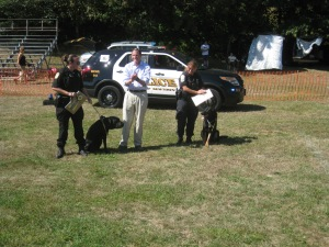 K-9 Officers Saint Michael and Trent get Canine Good Citizen medals and ribbons from U.S. Senator Richard Blumenthal at Trap Falls KC RDO Day.