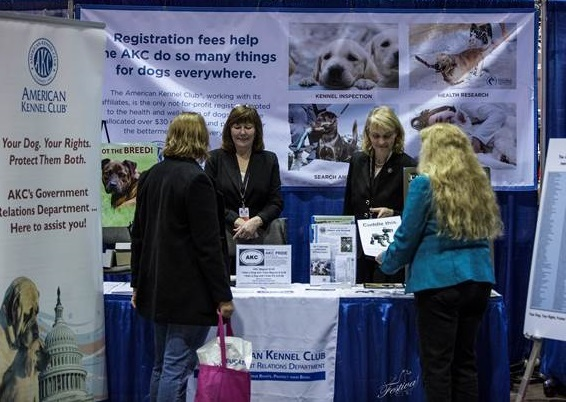 Exhibitors and guests at the 2014 AKC/Eukanuba National Championship view AKC Government Relations advocacy materials. Photo by Katie Rudolph.